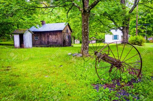 Old barn and farm equipment at  Millbrook Village, at Delaware W
