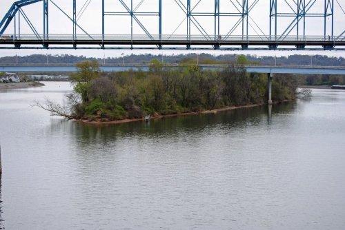 ten mac island in river
